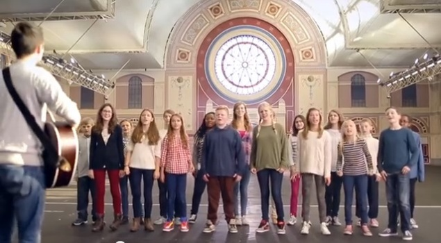 It's a youth choir singing an inspirational song. Run. RUN!