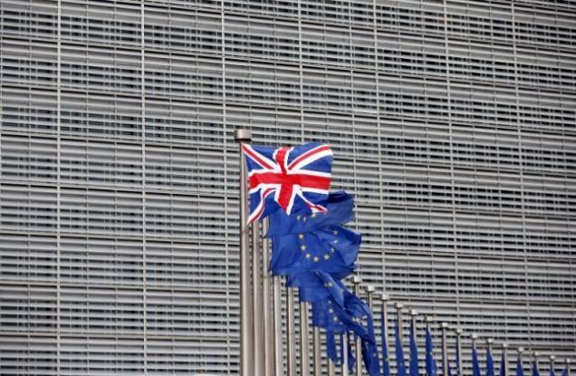 File photo of a Union Jack flag fluttering next to European Union flags ahead of a visit from Britain's Prime Minister David Cameron at the EU Commission headquarters in Brussels