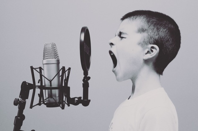 boy-shouting-microphone